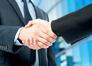 Business handshake, the deal Is finalized.