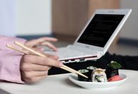 eating sushi at computer business idea