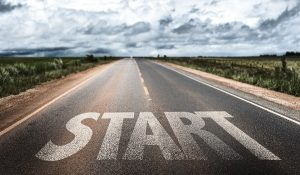 Start written on rural road
