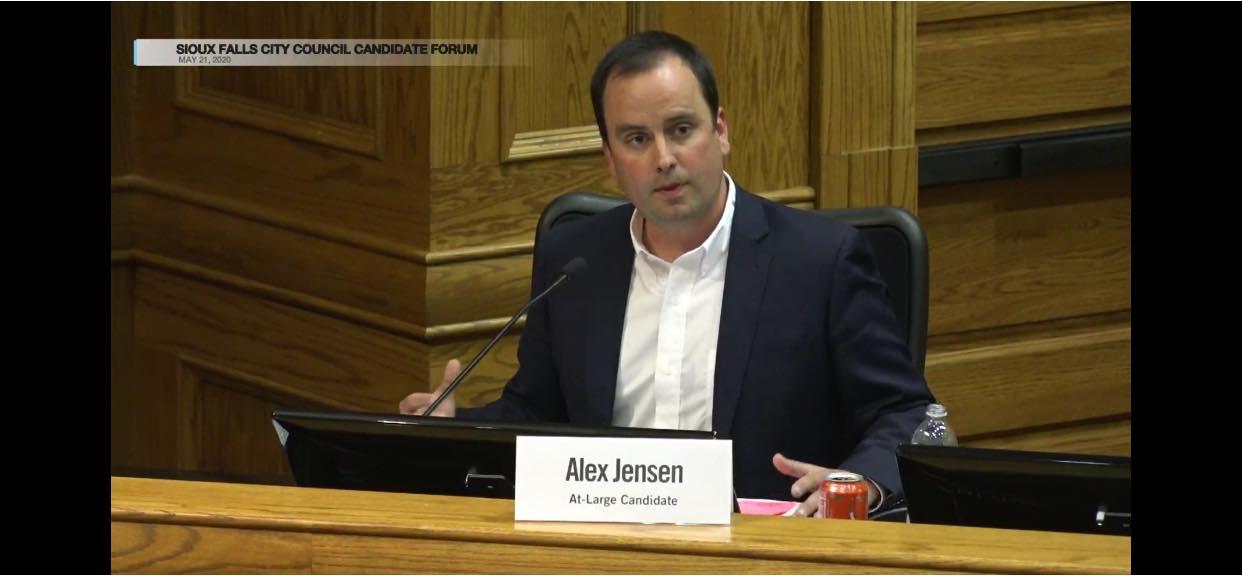 Alex speaking at a candidate forum
